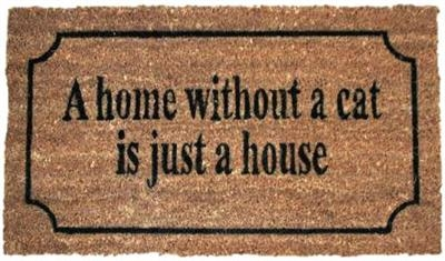 Måtte med tekst A home without a cat is just a house.